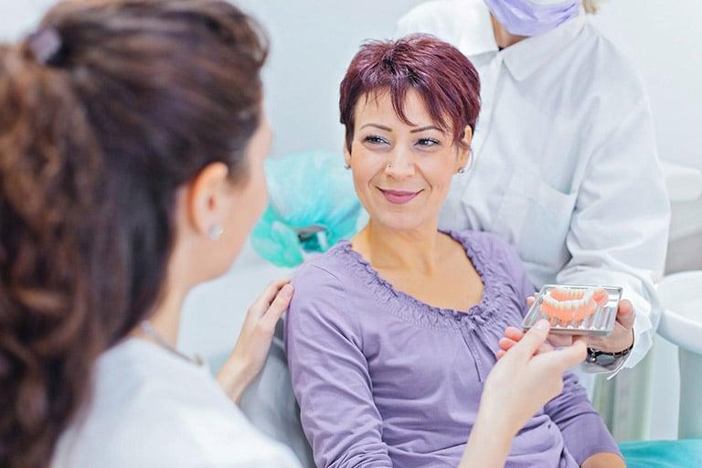 Dentists Educating Patient