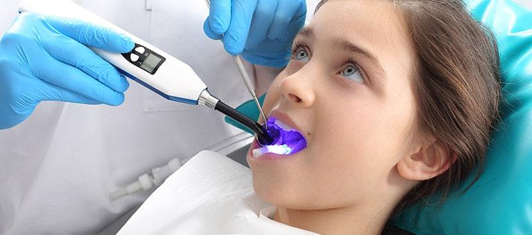 Dentist Applying Tooth Sealant
