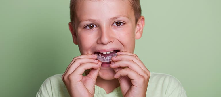 Child Wearing Mouthguard
